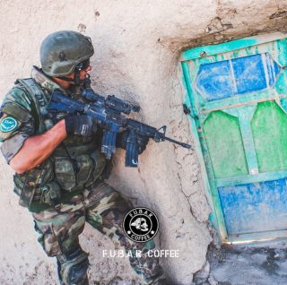 Co-founder Tom kicking down doors in Afghanistan in 2009. Note the C8 with grip that doubles as a magazine holder along with Aimpoint CompM4 and Aimpoint 3X magnifier   Tom opted to wear his Glock on his chest, seeing as he often adopted the role of top gunner on vehicle patrols and wanted to have quick access to it   What would your preferred load-out be if you were a SOF Operator?  Follow👉🏻 @f.u.b.a.r._coffee_company for the best of special forces and aviation     #coffee #coffeelover #coffeeaddict #ar15 #coffeeroasters #m4 #veteranowned #veterans #military #militaryfamily #specialforces #m16 #army #navy #diemaco #deployment #marines #colt #commando #aimpoint #warriors #coffeeporn #glock #aviators #specops #specialoperations #afghanistan #isaf #doorkickers #korpsmariniers